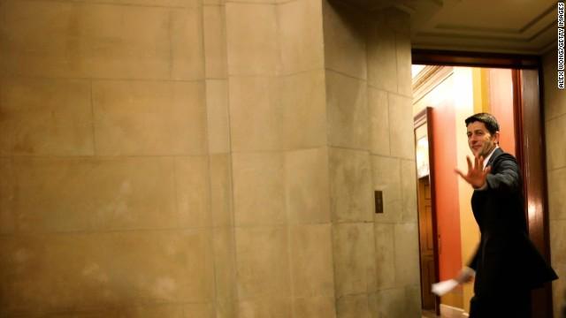 Rep. Paul Ryan waved at the media Friday as he headed to the office of House Speaker John Boehner.