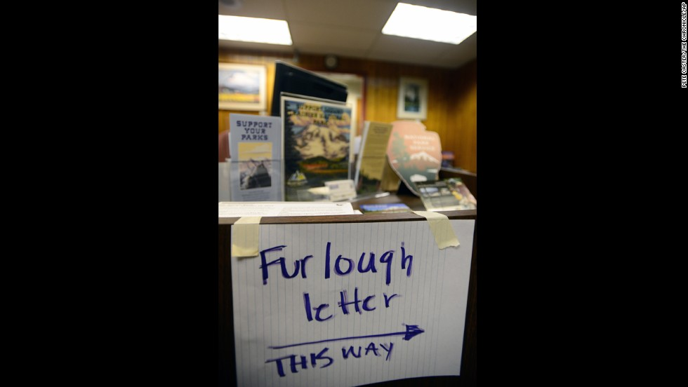 A handwritten sign at the Mount Rainier National Park administration building tells employees where to pick up their furlough letters October 1.