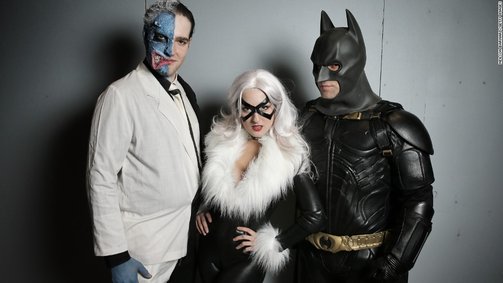 Comic conventions are for anyone, no matter which side you choose. These fans pose as Two-Face, left, Black Cat, and Batman.
