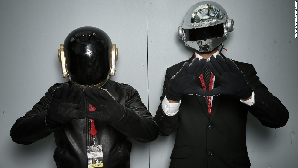 Hey! It's French electronic musical duo Daft Punk... or fans with eerily similar helmets.