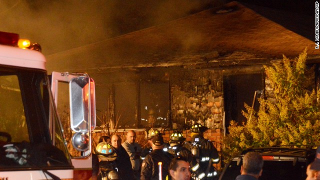 Jennifer Mccusker and her three kids died after a fire started at the front of their Long Island home, police said.