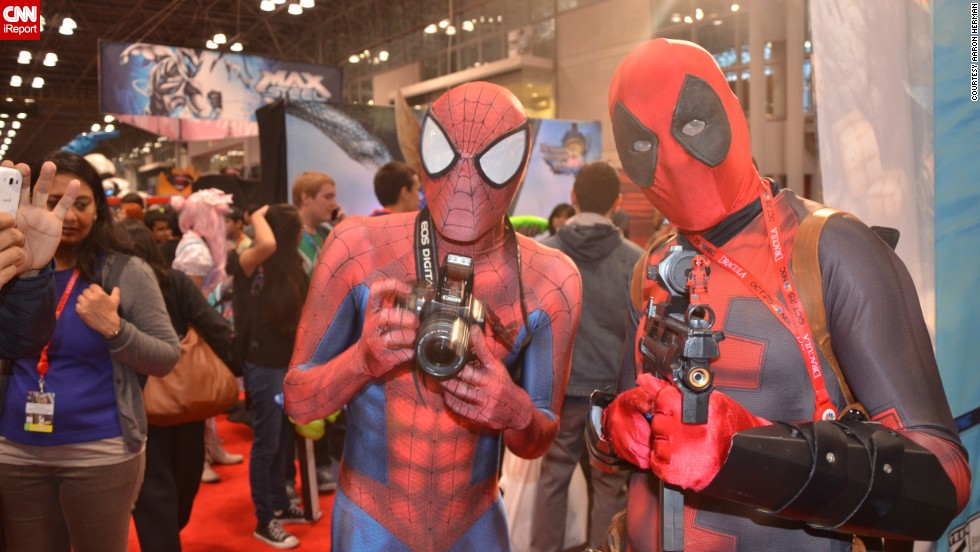 "Popular Marvel Comics characters <a href=""http://ireport.cnn.com/docs/DOC-1047487"">Spider-Man and Deadpool</a> pose with their accessories of choice."