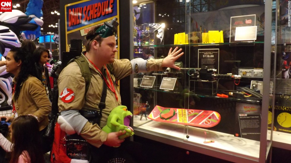 "Oh, those tempting toy booths. This <a href=""http://ireport.cnn.com/docs/DOC-1047657"">Ghostbuster </a>eyes an item at the Mattel booth."