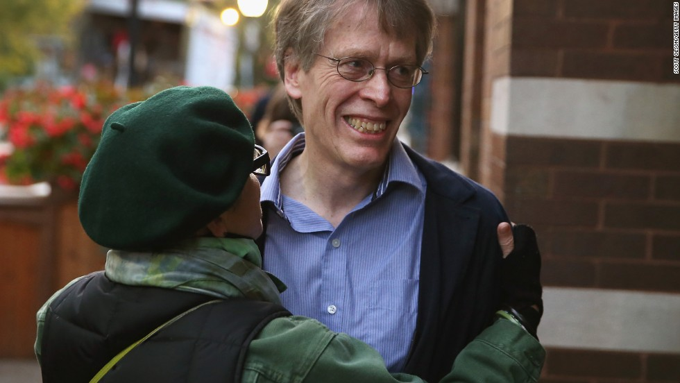 Hansen is congratulated by a friend Monday, October 14, after learning he had won the Nobel Prize. Hansen, Shiller and Fama concluded that while predicting the short-term price of stocks and bonds is virtually impossible, it is possible to forecast over longer periods.