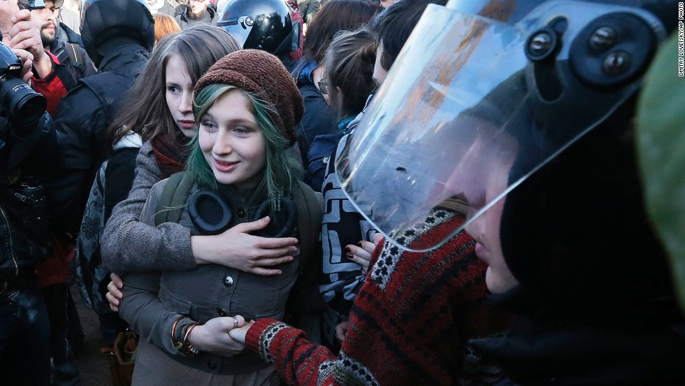 """OCTOBER 14 - ST. PETERSBURG, RUSSIA: Gay rights activists are surrounded by police and anti-gay protesters during a rally in St. Petersburg, which ended in scuffles and violent clashes. An international backlash <a href=""""http://www.cnn.com/2013/08/07/world/europe/russia-gay-rights/"""">against Russia's recently-adopted anti-gay propaganda law</a> is gathering speed, as the country prepares for the <a href=""""http://www.cnn.com/2013/08/02/opinion/ghitis-anti-gay-russia-games/index.html"""">2014 Winter Olympics in Sochi</a>."""