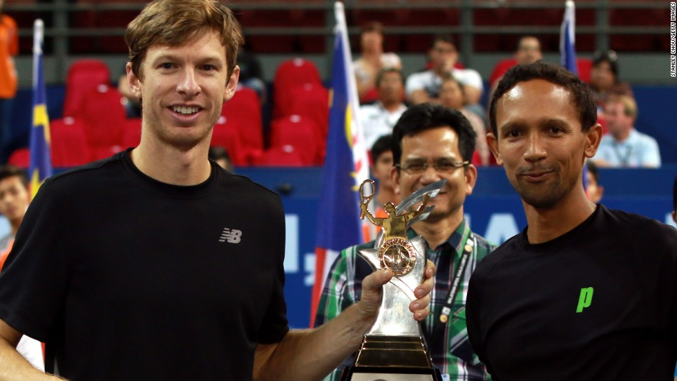 Eric Butorac (left) with doubles partner Raven Klaasen after winning the Malaysian Open title. Butorac has paid close attention to diet during his long career.