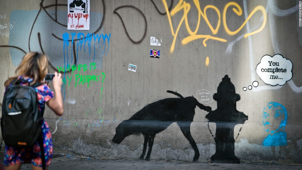 A Banksy mural of a dog urinating on a fire hydrant draws attention
