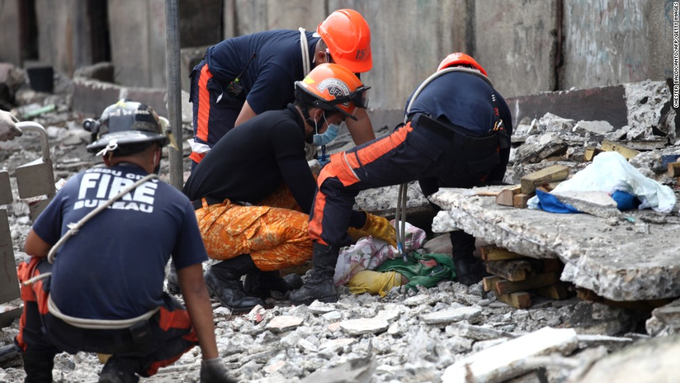 Rescuers pull a man from the rubble in Cebu on October 15.