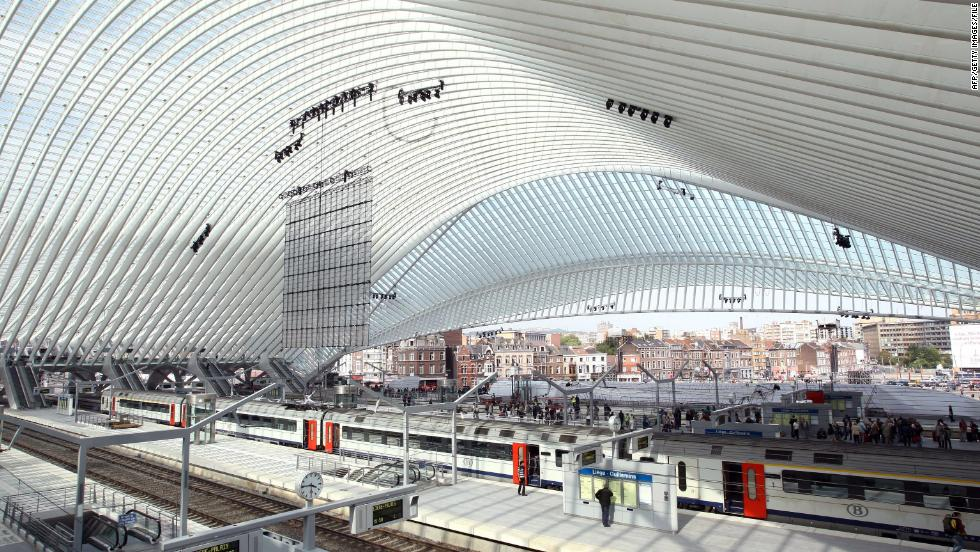 The interior of the Liège-Guillemin station in Liege, Belgium. The facility's ultra-modern glass and steel facade is featured in promotional posters for upcoming Wikileaks docu-drama, The Fifth Estate, starring Benedict Cumberbatch. Although far from Belgium's biggest or busiest station, Liège-Guillemin is fully equipped for high speed arrivals and departures as well as commuter trains.