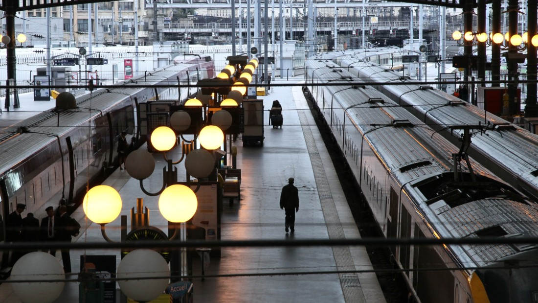 Trains wait on the platform of the Gare du Nord Station in Paris.