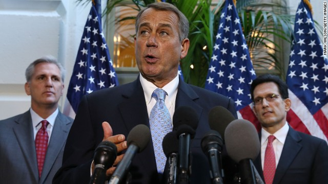 House Speaker John Boehner speaks to the media while flanked by House Majority Leader Eric Cantor, right, and Rep. Kevin McCarthy following a House Republican caucus meeting at the Capitol in Washington on October 15, 2013.
