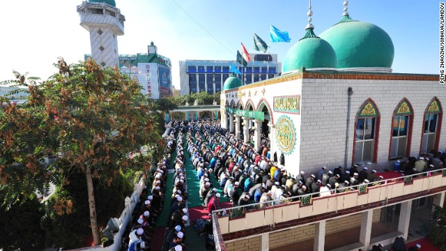 Muslims pray during Eid Al-Adha at the Nanguan mosque in Yinchuan, China, on October 15.