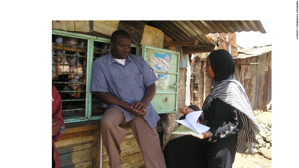 "His organization ""Pambazuko Mashinani"" has a variety of social change programs in reproductive health, women's empowerment and youth outreach. Pictured, one of the group's volunteers conducts a field interview surveying people about tuberculosis."
