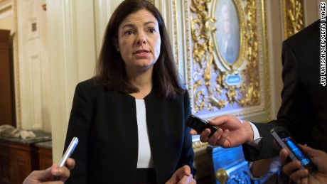 US Senator Kelly Ayotte, R-NH, walks to the weekly policy luncheon on Capitol Hill in Washington, DC, October 15, 2013.  Washington's risky game of political brinkmanship neared crisis point Tuesday, with no deal yet nailed down to avoid a catastrophic US debt default, just 36 hours before a crucial deadline. Despite global fears that the US government could run out of money to pay its bills on Thursday, the rift cleaving US politics and a fight for the soul of the Republican Party thwarted compromise. Hopes a nascent deal between Republicans and Democrats in the Senate would open the way to resolve a fight over raising the US borrowing limit and reopening government proved over optimistic.   AFP PHOTO / Jim WATSON        (Photo credit should read JIM WATSON/AFP/Getty Images)