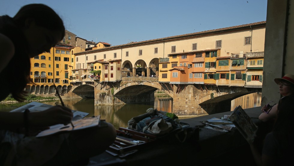 "Sunset over the medieval arch bridge Ponte Vecchio in Florence rarely disappoints visiting lovebirds. If you're planning a visit, this list of <a href=""http://edition.cnn.com/2013/08/05/travel/10-things-italy-does-better/index.html"">things Italy does best</a> will help you prepare."