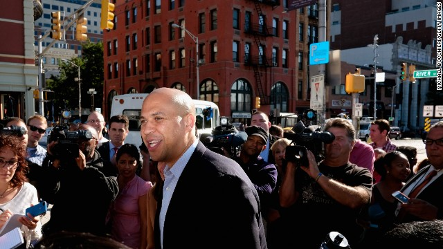 Newark Mayor Corey Booker greets people at the Hoboken PATH station after winning the Democratic primary for U.S. Senate on August 14, 2013 in Hoboken, New Jersey. Booker will face off in a special October election against Republican challenger former Bogota, NJ mayor Steve Lonegan to fill the empty U.S. Senate seat left formerly held by U.S. Sen. Frank Lautenberg, who died on June 3rd.