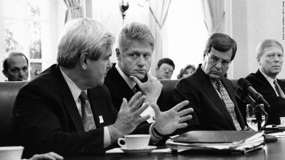 President Bill Clinton, second from left, and Senate Minority Leader Trent Lott, third from left, listen to House Speaker Newt Gingrich in the White House Cabinet Room in February 1996. Clinton and Democrats worked with Gingrich, Lott and other Republicans that year to pass landmark welfare reform.