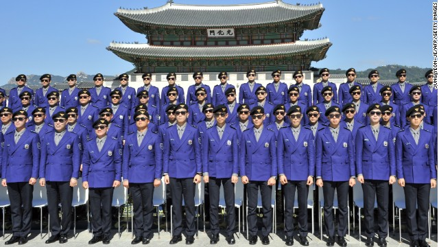 Seoul's multi-lingual tourism police force, decked out in Psy-inspired uniforms, attend their inauguration ceremony at Seoul's Gwanghwamun Square. No prizes for those who guess which song was played during the event.