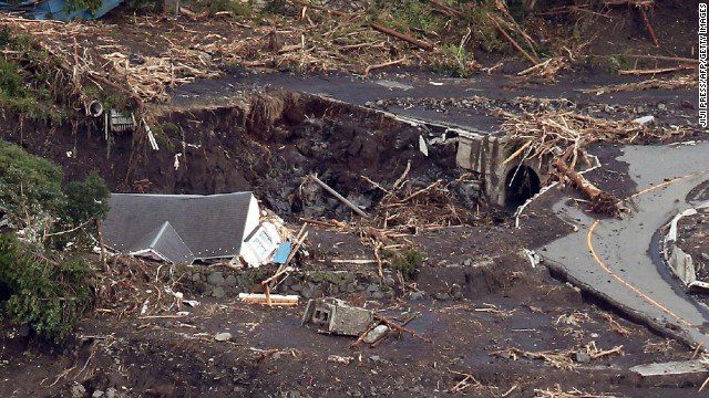 Typhoon Wipha lashed Japan's Pacific Coast, killing at least 18 people and leaving more than 40 missing.
