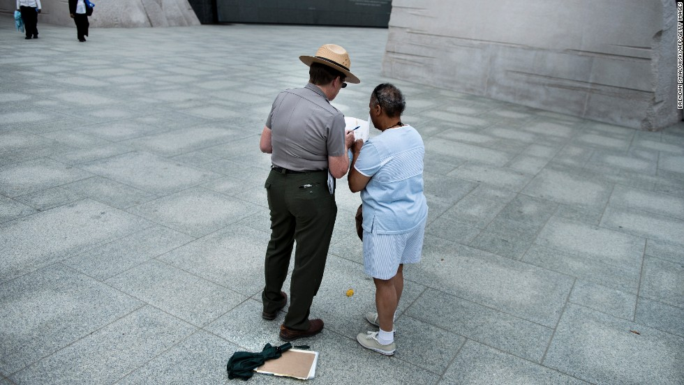 A U.S. park ranger helps a tourist at the Martin Luther King Jr. Memorial in Washington on October 17.