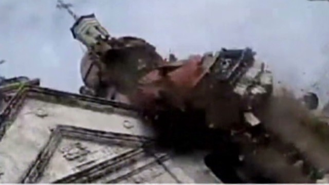 Bell tower crumbles on camera in quake