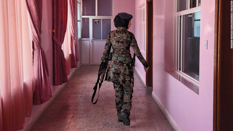 A female member of Yemen's elite counterterrorsim unit checks the barracks, in this photo from Stephanie Sinclair.
