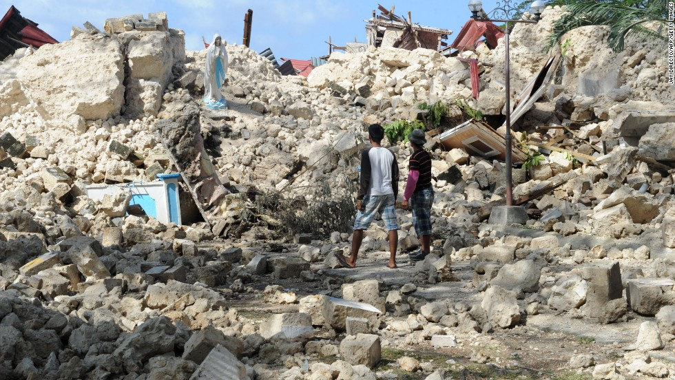 Residents view the ruins of the historic Holy Cross Parish Church in Maribojoc on the central Philippine island of Bohol on Friday, October 18. The death toll has risen above 180 after a magnitude-7.1 earthquake on October 15.
