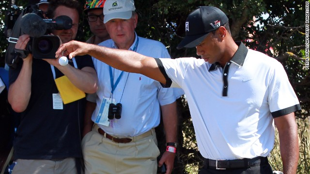 U.S. golfer Tiger Woods takes a drop in the rough during the first round of the 2013 British Open at Muirfield in July.