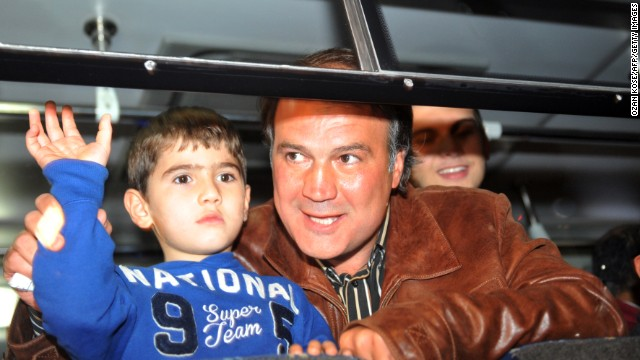 Turkish Airline pilot Murat Akpinar, who was kidnapped in Beirut, reunites with his family, October 19, 2013.