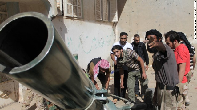 Members of the Jund al-Rahman Brigade on the front lines of Syria's northeastern city of Deir Ezzor on October 2, 2013.