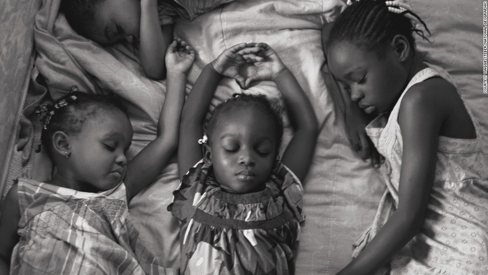 Photographer Maggie Steber took this photo of four young sisters in Miami, Florida, napping on a Sunday afternoon after attending church, as part of a feature on sleep.