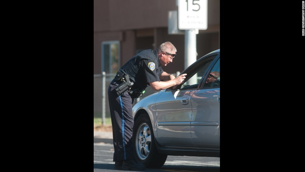 A police officer stops traffic near Agnes Risley Elementary.