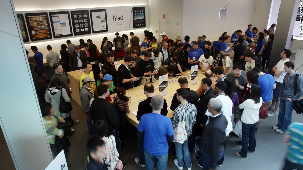Shoppers line up outside an Apple Store in the SoHo neighborhood of New York to be among the first to buy an iPad on April 3, 2010.
