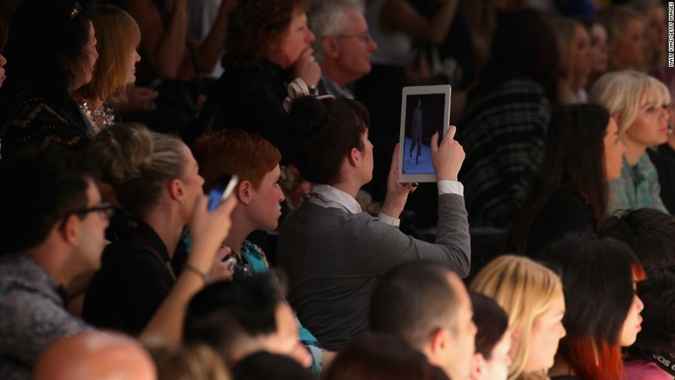 An audience member uses an iPad to photograph a fashion show  on May 1, 2012 in Sydney, Australia.