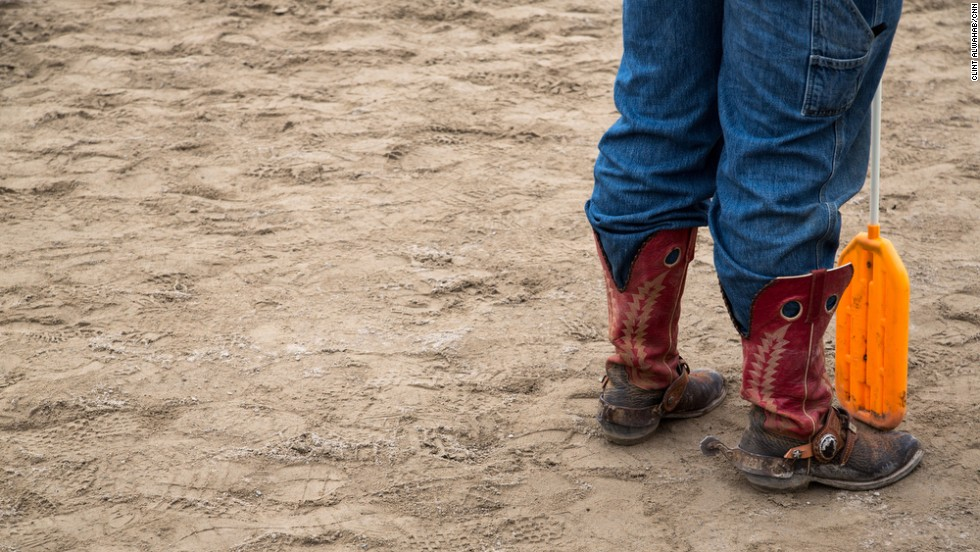 A herder pauses on the track in between bull runs.