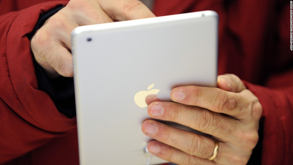 A man uses a iPad Mini, which was released by Apple on November 2, 2012. Here's a look back at the history of the iPad, the tablet computer that Apple first introduced in 2010.
