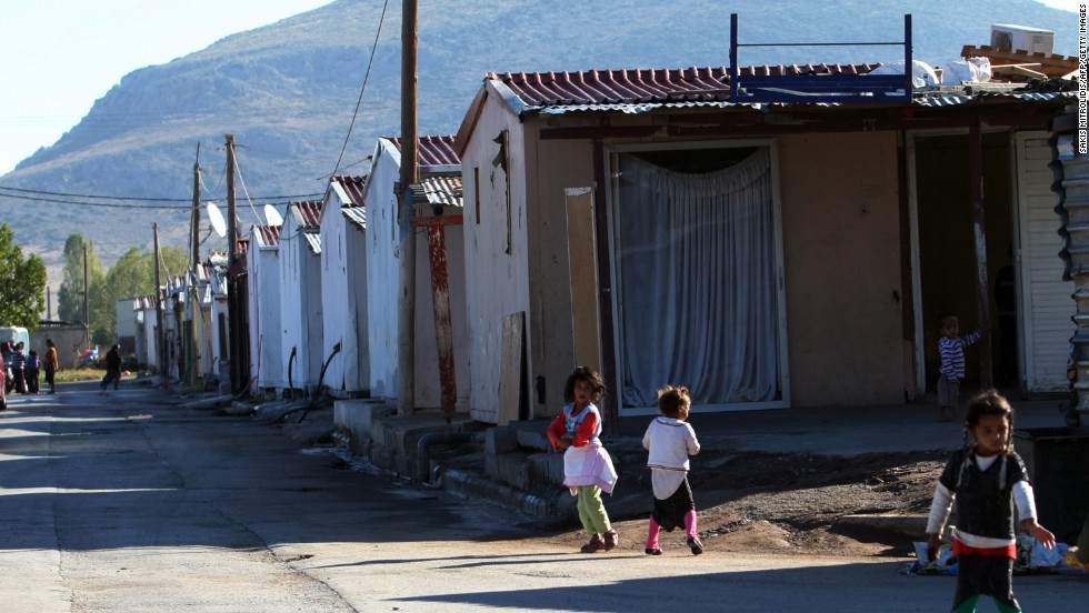 "Roma children play next to a Roma settlement in Farsala, Greece, on Saturday, October 19. Haralambos Dimitriou, head of the local Roma community, said Dimopoulou and Salis raised Maria like a ""normal"" child."