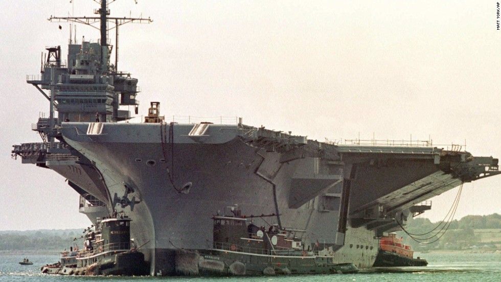 The U.S. Navy announced Tuesday that the former aircraft carrier USS Forrestal had been sold for scrap for one penny. The ship will be towed from its berth in Philadelphia to Brownsville, Texas, for dismantling. The Forrestal, named after former Secretary of Defense James Forrestal, was decommissioned in 1993. Here, it is is guided into Coddington Cove in Middletown, Rhode Island, in September 1998.
