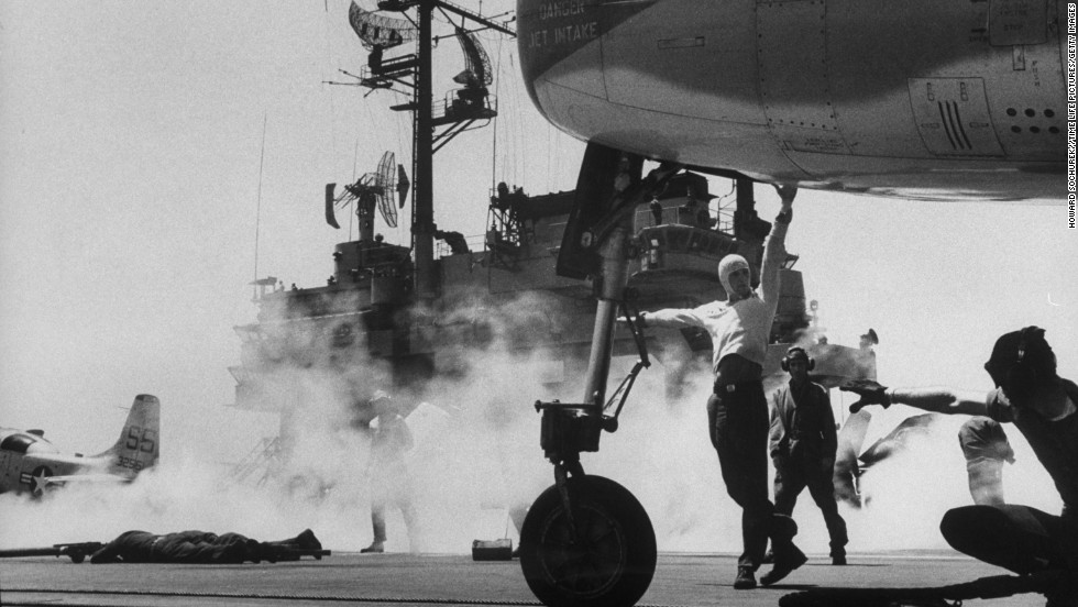 """Displacing 56,000 tons and with a length of 1,039 feet, the USS Forrestal was regarded as the U.S. Navy's first """"supercarrier"""" when it was launched in 1954. Circa 1957, a plane prepares to take off from the Forrestal's flight deck."""