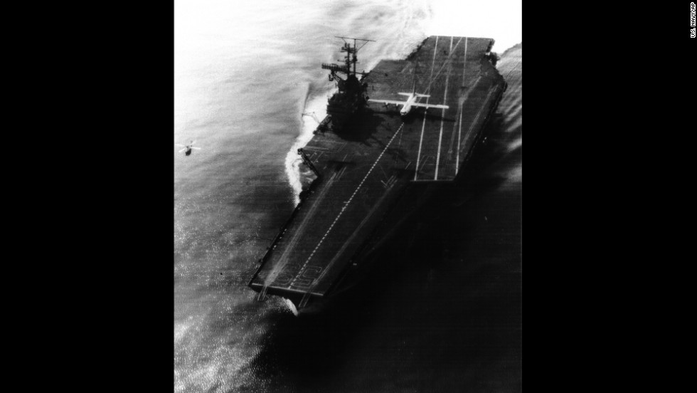 A Marine Corps KC-130 plane sits on the flight deck of the USS Forrestal after landing, in November 1963. The event marked the largest and heaviest plane to land on a carrier.