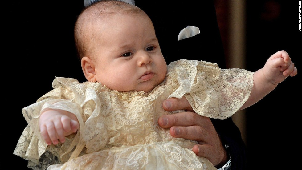 Prince George is wearing an outfit made of delicate Honiton lace and white satin by Angela Kelly, an exact replica of the one worn before him by every baby born to the British Royal family since 1841.