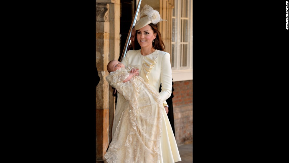 Catherine holds Prince George after his christening.