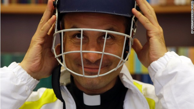 Monsignor Sanchez de Toca y Alameda wears a helmet during the presentation of the Vatican cricket club on October 22.