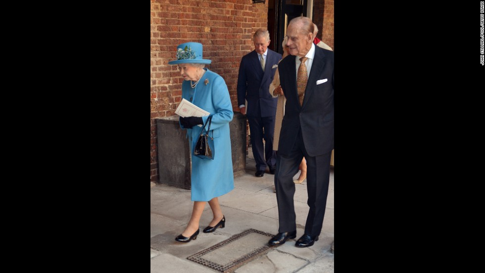 Queen Elizabeth II and Prince Philip, followed by Prince Charles, leave the Chapel Royal following the christening of the Queen's great-grandson.