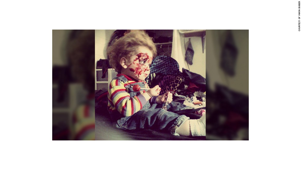 """Last year Maya Buber dressed up her son Silas as Chucky from the movie Childs Play because """"he looks just like him"""" and she loves the movie. """"I took this photo right after we had been trick-or-treating as he was having a sugar overdose on my bed. Some people loved this idea of mine and some were completely against this as I may traumatize my child, but I have an open mind,"""" said the pest controller from Arizona who is re-training to become a funeral director."""