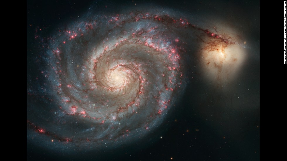 The Whirlpool Galaxy's spirals are made up of long lanes of stars and gas laced with dust. Some astronomers believe that the arms are so prominent because of the effects of NGC 5195, the small, yellowish galaxy at the outermost tip of one of the Whirlpool's arms.