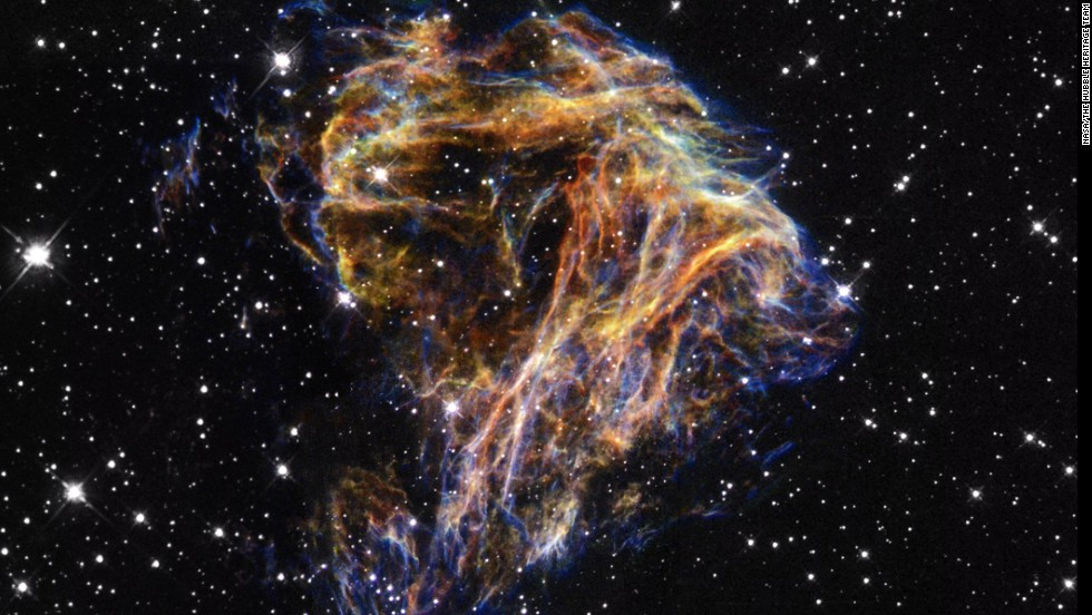 DEM L 190's filaments are sheets of debris from a stellar explosion in a neighboring galaxy.