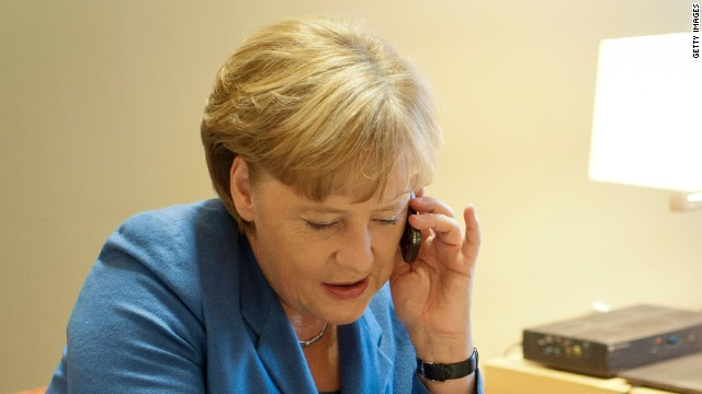 German Chancellor Angela Merkel speaks on a mobile phone on October 23, 2011 in Brussels, Belgium.
