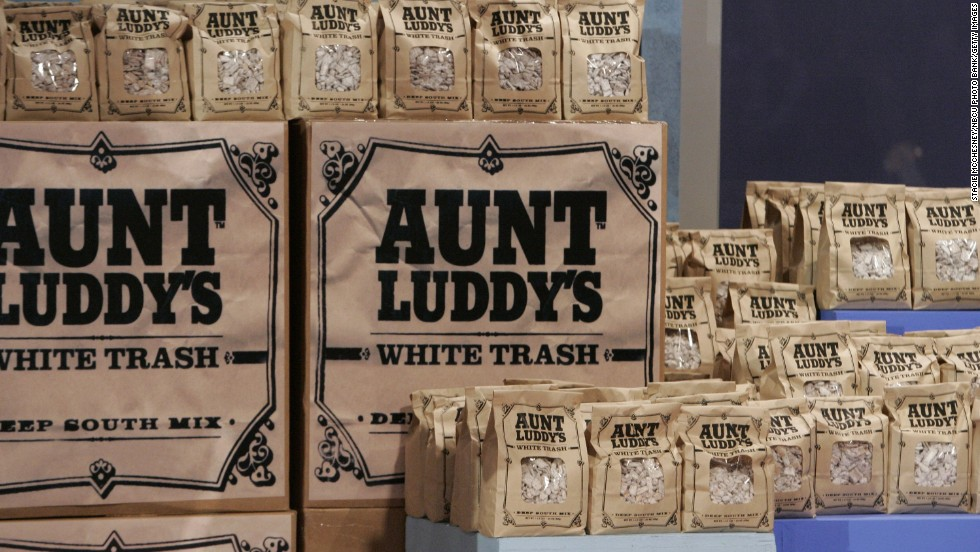 Aunt Luddy's White Trash is a snack sold at Walton's Fancy and Staple, a gourmet deli and bakery in Austin, Texas, owned by actress Sandra Bullock.
