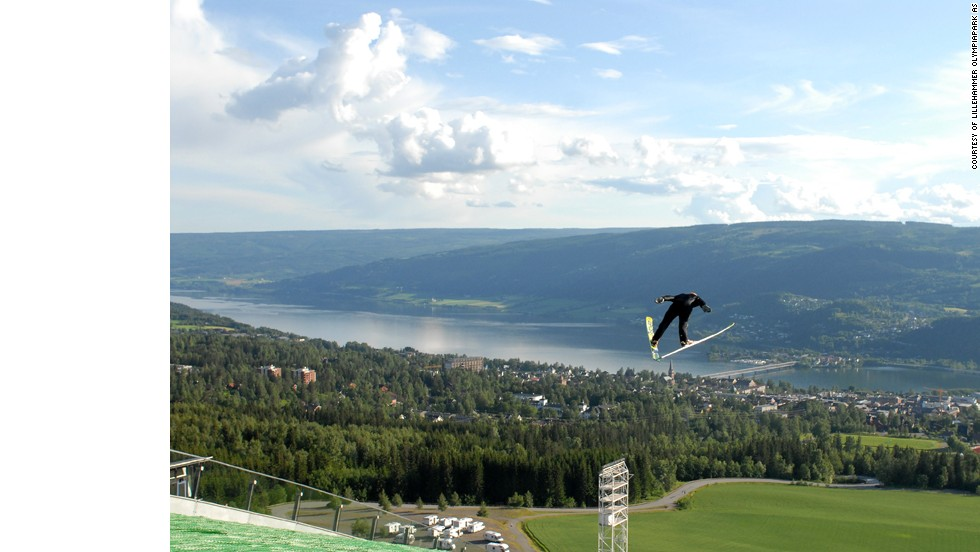 The ski jump facilities can be used all year thanks to an artificial turf covering. Lillehammer and Lake Mjosa can be seen in the background.